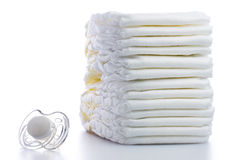 Stack of Nappies and Pacifier Royalty Free Stock Photo