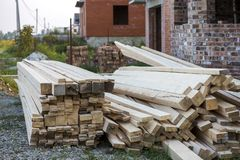 Stack of natural brown uneven rough wooden boards on building si stock images