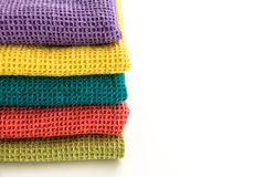 Stack of neatly folded colorful kitchen towels. On white background Royalty Free Stock Photos