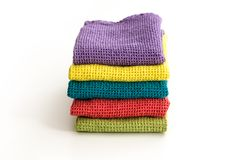 Stack of neatly folded colorful kitchen towels. On white background Royalty Free Stock Photography