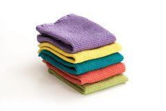 Stack of neatly folded colorful kitchen towels. On white background Stock Photo