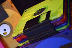 Stack of neon colored floppy disks Royalty Free Stock Photo