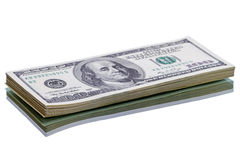 Stack new of $100 dollar bills. Isolated on white background royalty free stock images
