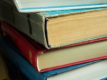 A stack of new and old books with frayed covers and yellowed pages Stock Photography