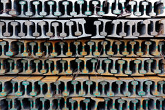 The stack of new rails. New rails stacked in a pile and form a pattern Stock Photo