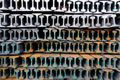 The stack of new rails. New rails stacked in a pile and form a pattern Royalty Free Stock Photos