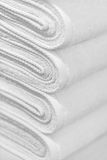 Stack of new white towels close-up - background Royalty Free Stock Image