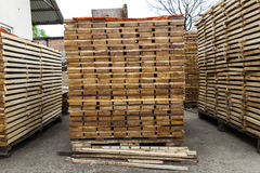 Stack of new wooden boards and studs at the lumber yard. Wooden Stock Image