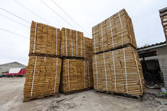 Stack of new wooden boards and studs at the lumber yard. Wooden Royalty Free Stock Photography