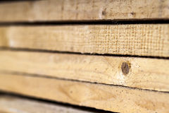 Stack of new wooden studs at the lumber yard. Wood timber constr Stock Photos