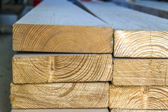 Stack of new wooden studs at the lumber yard. Wood timber constr Stock Photography