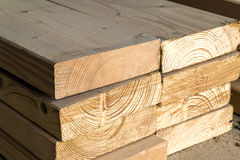 Stack of new wooden studs at the lumber yard. Wood timber constr Stock Image
