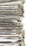 Stack of newspaper on white background Stock Photos