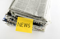 Stack of newspaper write news word Royalty Free Stock Photo