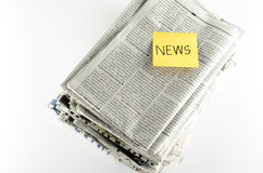 Stack of newspaper write news word Royalty Free Stock Images