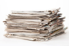 Stack of newspapers. Isolated of white background Royalty Free Stock Photography