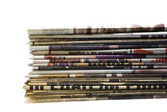 Stack of newspapers. Stack of old and new newspapers isolated over white Royalty Free Stock Images