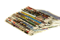 Stack of newspapers. Stack of old and new newspapers isolated over white Royalty Free Stock Photography