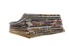 Stack of newspapers. Stack of old and new newspapers isolated over white Stock Photography