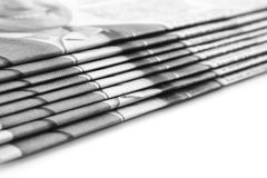 Stack of newspapers. Over white (Shallow DOF Royalty Free Stock Photography