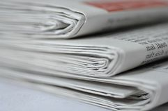 Stack of newspapers. A closeup of three sets of newspapers, placed in a stack Royalty Free Stock Photo