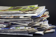 Daily stack of newspapers Royalty Free Stock Photos