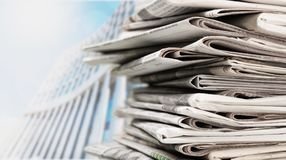 Stack of newspapers on background. Paper newspaper news pile pile of newspapers print media paper stack Stock Photography