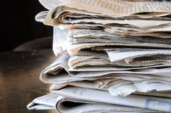 Stack of  newspapers. Stack of newspapers on black table Royalty Free Stock Photos