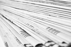 Stack of newspapers in black and white isolated Royalty Free Stock Photography