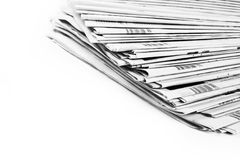 Stack of newspapers in black and white isolated Stock Image