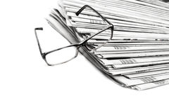Stack of newspapers in black and white isolated Stock Images