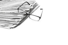 Stack of newspapers in black and white isolated Stock Photo
