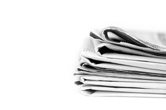 Stack of newspapers in black and white isolated. On white background Stock Photography