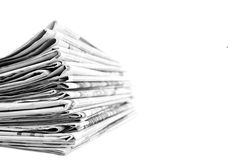 Stack of newspapers in black and white isolated royalty free stock image