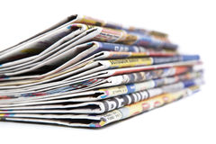 Stack of newspapers close-up. On white Royalty Free Stock Image