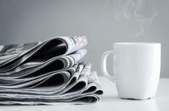 Stack of newspapers. And coffee Royalty Free Stock Photo