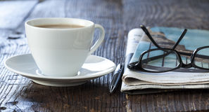 Stack of newspapers and coffee Stock Image
