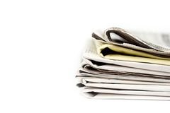 Stack of newspapers in color isolated. On white background Stock Photos