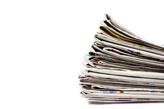 Stack of newspapers in color isolated Royalty Free Stock Images