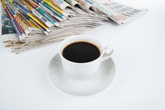 Stack of newspapers with cup of coffee close-up Royalty Free Stock Photo