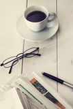 Stack of newspapers with eyeglassesand coffee Royalty Free Stock Image