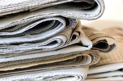 Stack of  newspapers. Stack of folded newspapers in kiosk Stock Photos