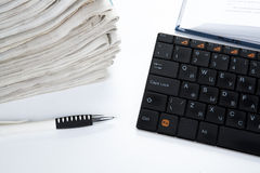 Stack of newspapers and keyboard Stock Photos