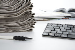 Stack of newspapers and keyboard Royalty Free Stock Photos