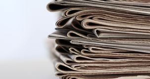 Stack of newspapers. Stack of old newspapers on white background stock video footage