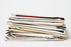 Stack of newspapers. On white background royalty free stock photos