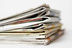 Stack of newspapers. On white background stock photography