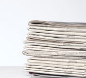 Stack of newspapers. White background Stock Photo