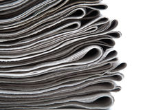 Stack of newspapers on a white background Stock Image