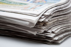 Stack of newspapers on a white background Royalty Free Stock Photography